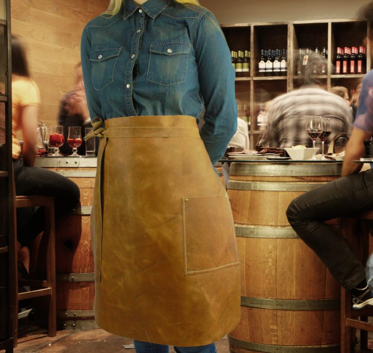 Long leather waist apron in bar worn by model