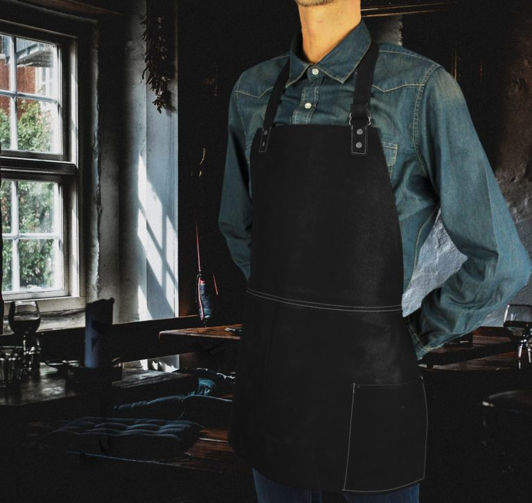 Short leather bib apron worn by model
